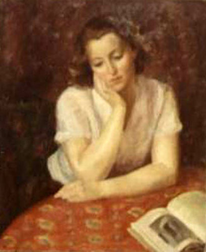 Woman Seated At Table With Orange Cloth