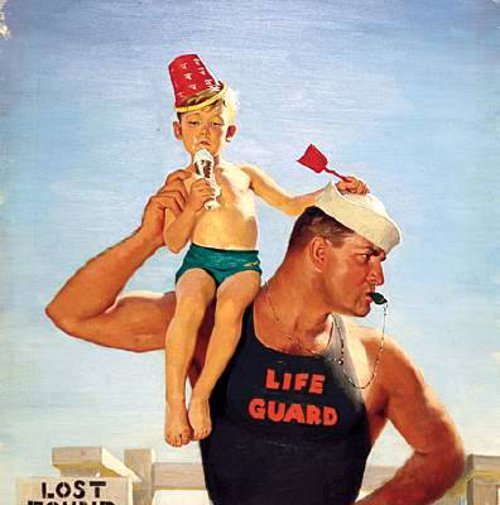 Life Guard Holding Lost Boy