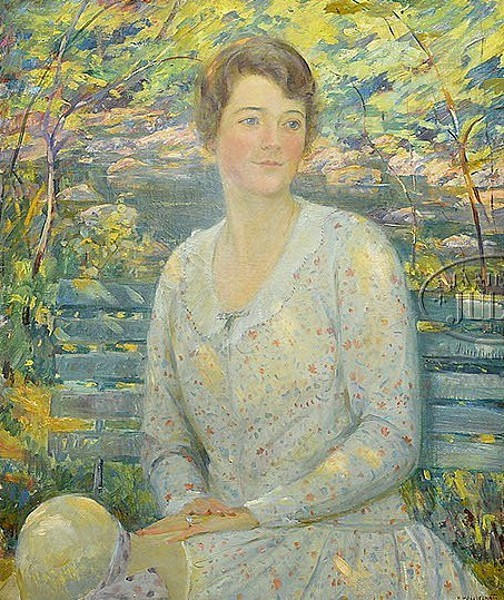 Woman Seated On A Park Bench