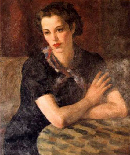 Woman In Black Dress Seated At Table