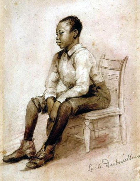 Black Boy Seated On A Chair