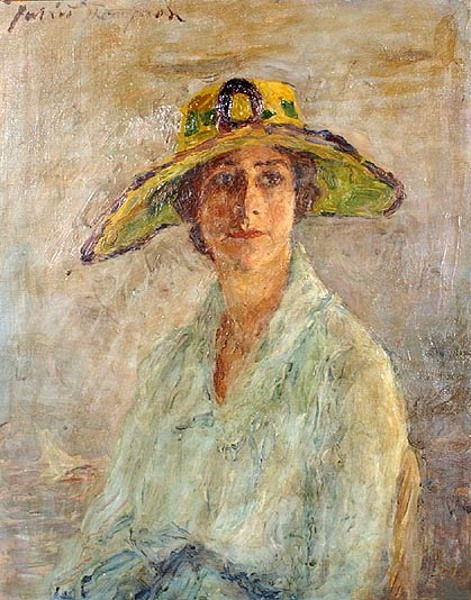 Lady Wearing A Yellow Hat