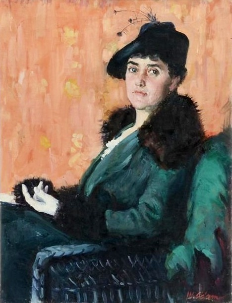 Woman Wearing A Hat With Feathers And A Green Coat